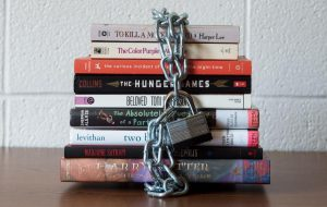 Pile of books padlocked with a chain