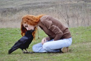 Woman with raven friend